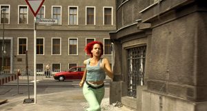 A woman with brightly dyed red hair runs down a city street in the German film Run, Loyla, Run