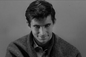Norman Bates grins menacingly in Anthony Perkins's portrayal from the 1960 film Psycho